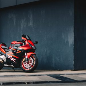 photo-of-red-and-black-honda-sport-bike-parked-next-to-black-2317519